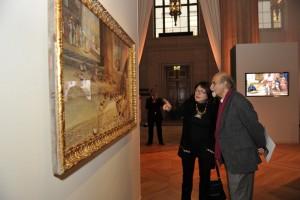 Guests discuss an artwork