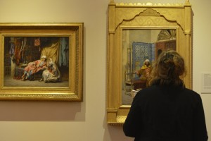 A guest admires the artwork