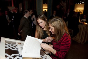 Guests reviewing the new book, Masterpieces of Oriental Art