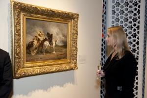 Faith Baranowski viewing painting
