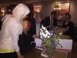 Dr Gregory Copley gifts and signs books for Fellows
